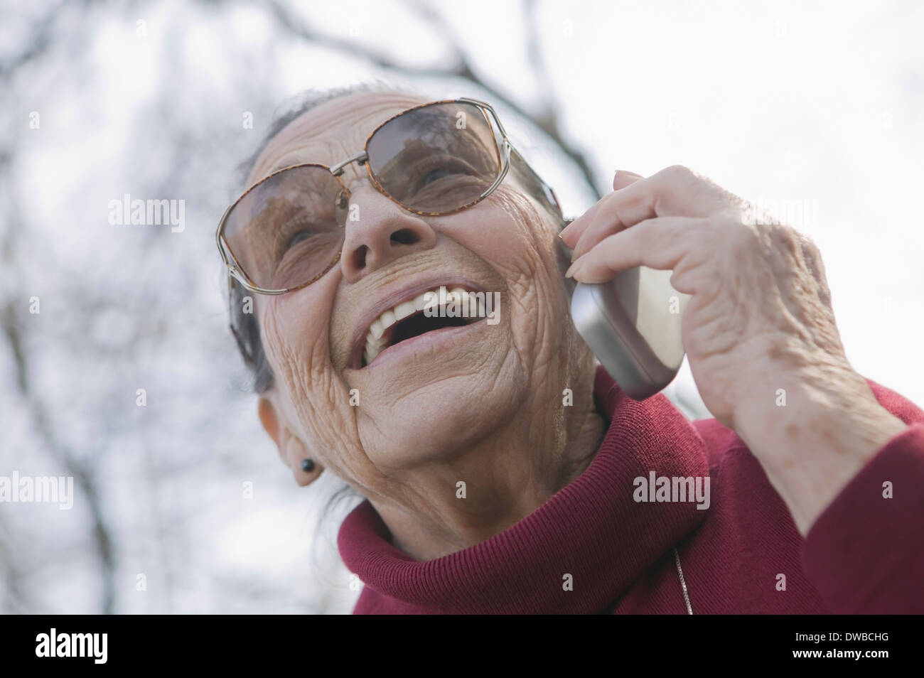 Portrait of senior woman on the phone - Stock Image