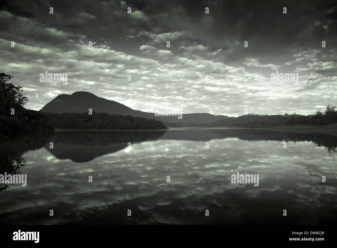 Sri Lanka, Uva, Wellawaya, freshwater lake in the evening - Stock Image