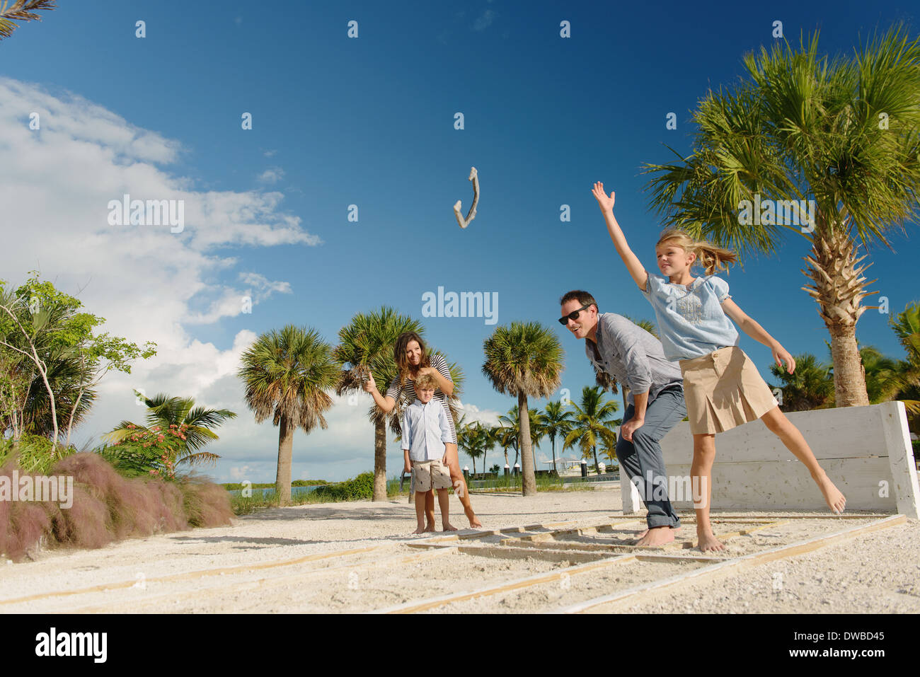 Family playing horseshoe game, Providenciales, Turks and Caicos Islands, Caribbean - Stock Image