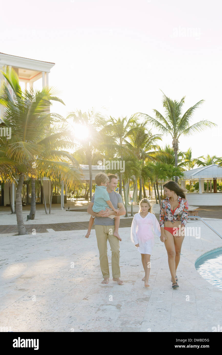 Family strolling in luxury resort, Providenciales, Turks and Caicos Islands, Caribbean - Stock Image