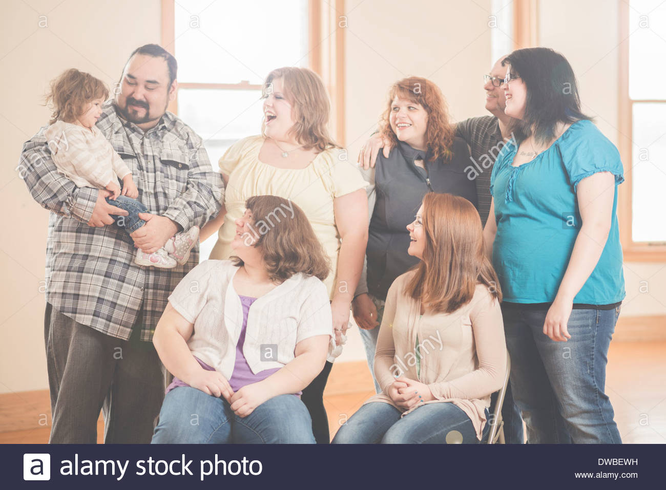 Family group portrait of three generations - Stock Image