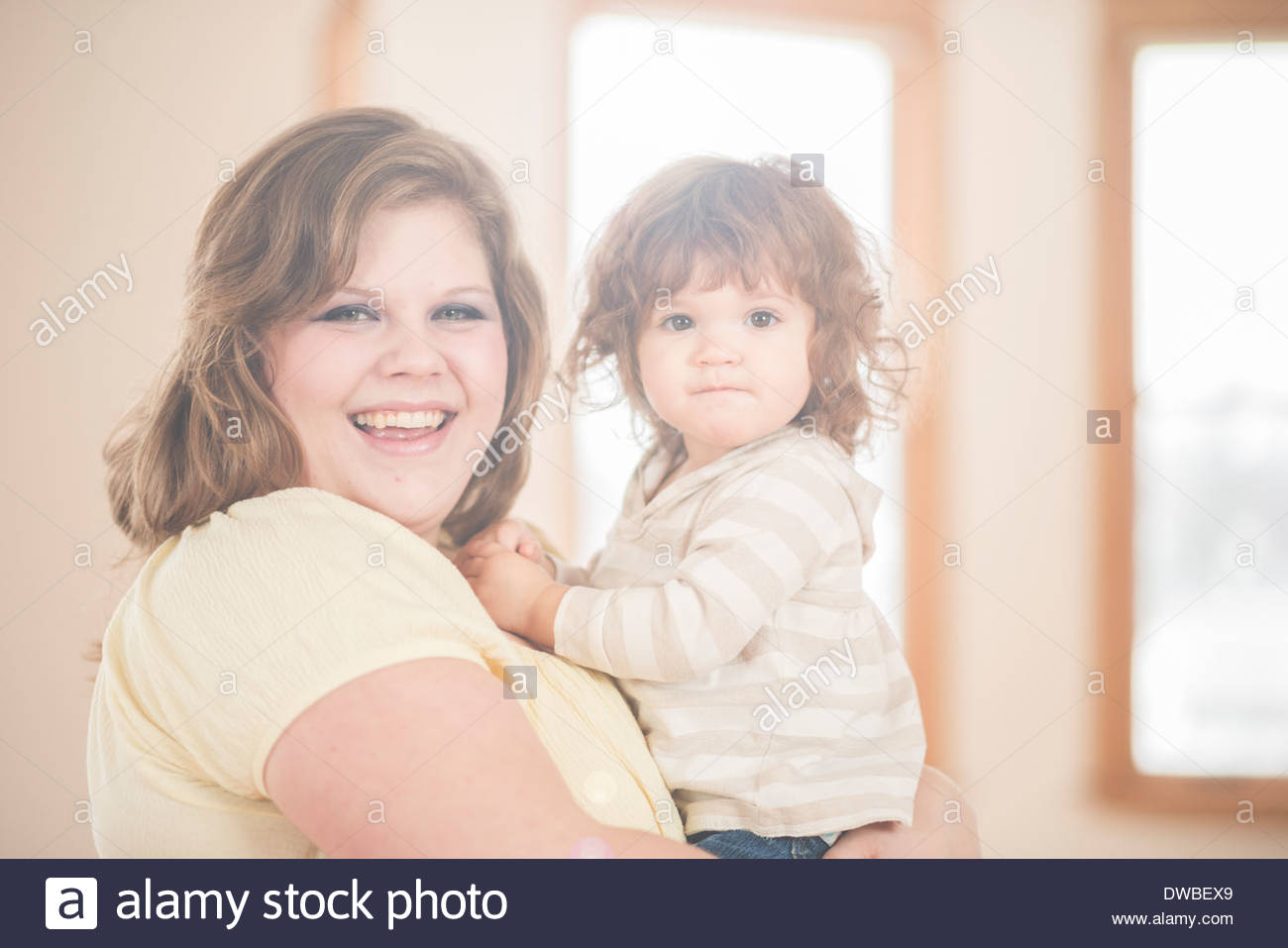 Female toddler and adoring mother - Stock Image