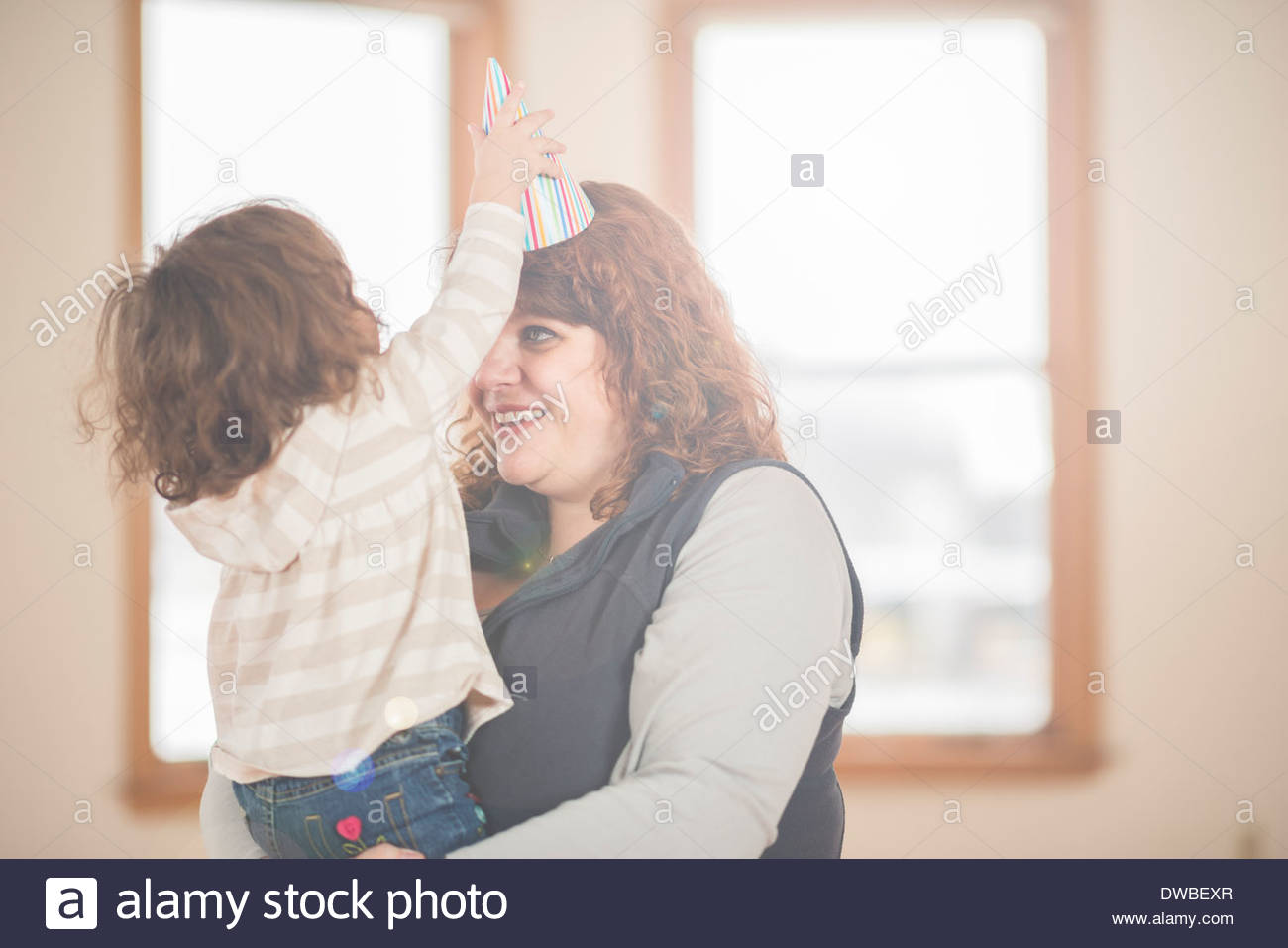Female toddler and adoring grandmother - Stock Image