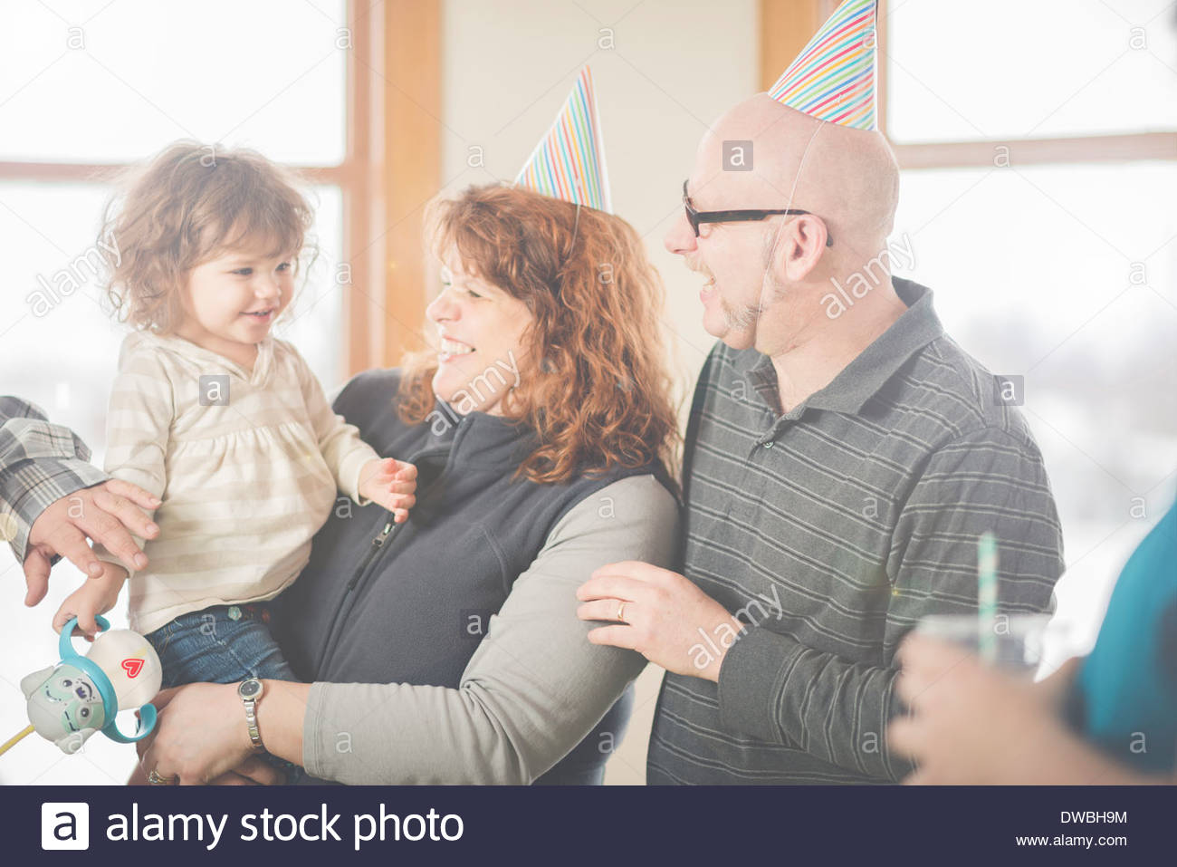 Female toddler and adoring family - Stock Image