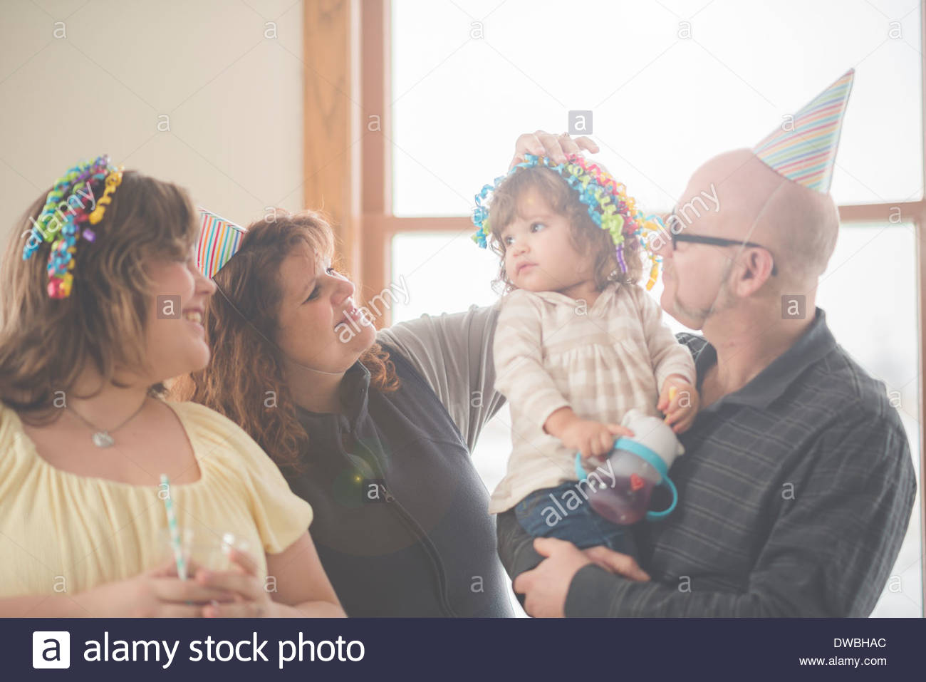 Mature man with daughters and granddaughter - Stock Image