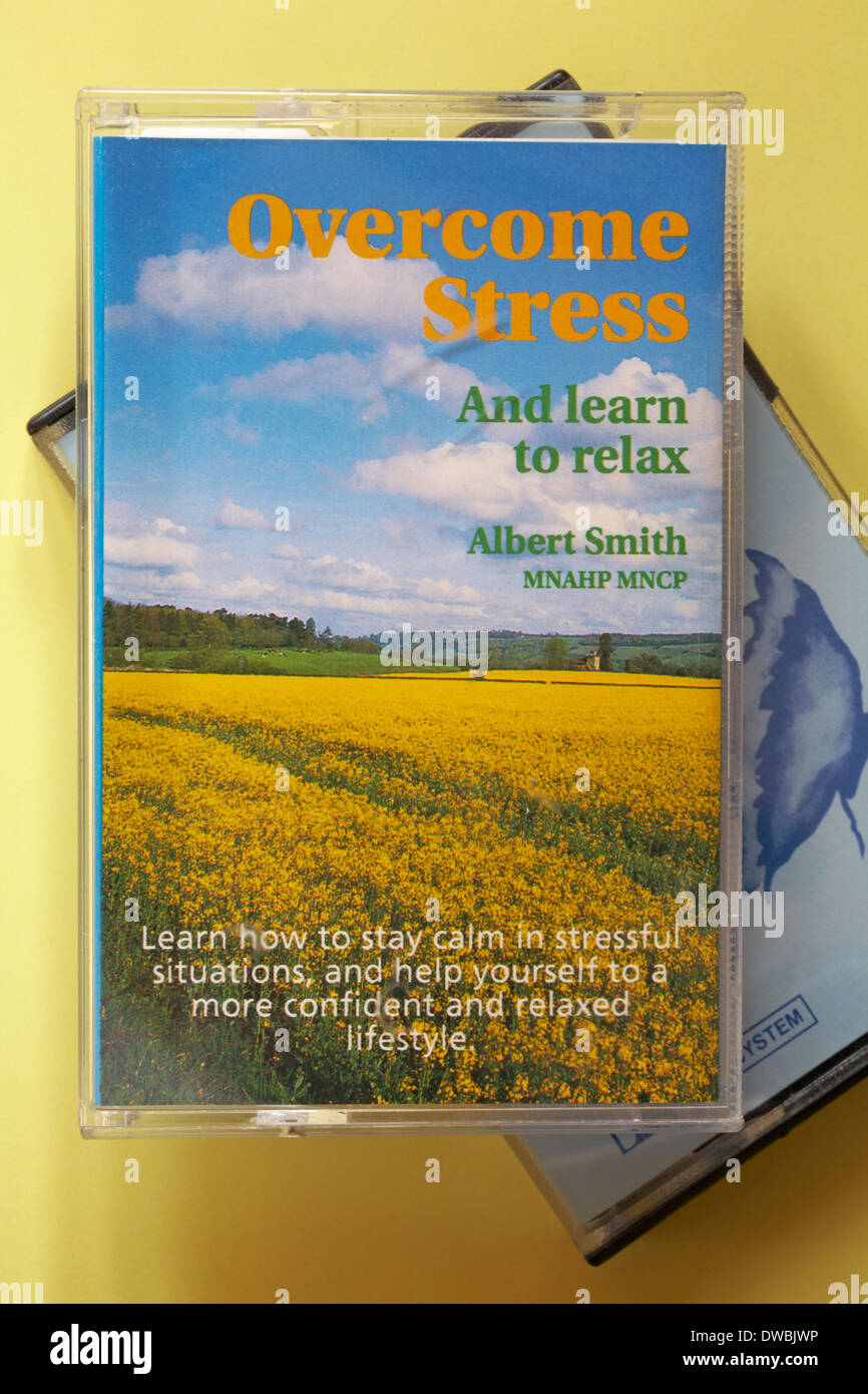 Overcome stress and learn to relax cassette tape by Albert Smith MNAHP MNCP set on yellow background - Stock Image