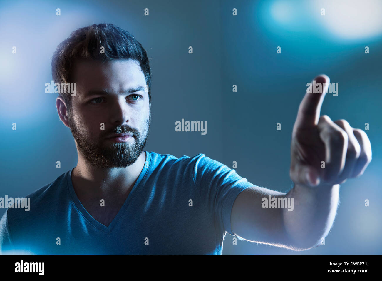 Man pointing on imaginary touchscreen - Stock Image
