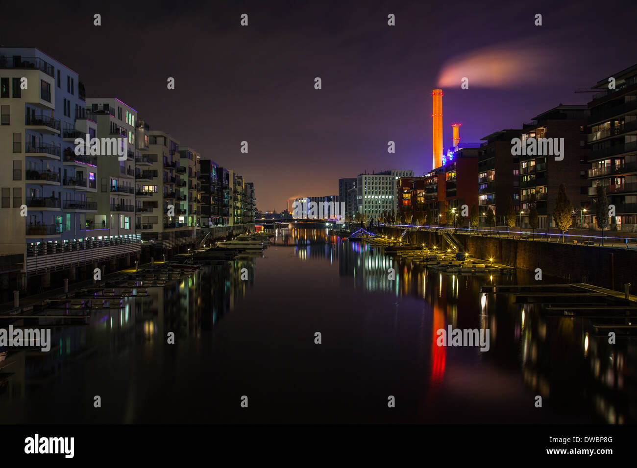 Germany, Hesse, Frankfurt, Residential buildings at Westhafen at night Stock Photo