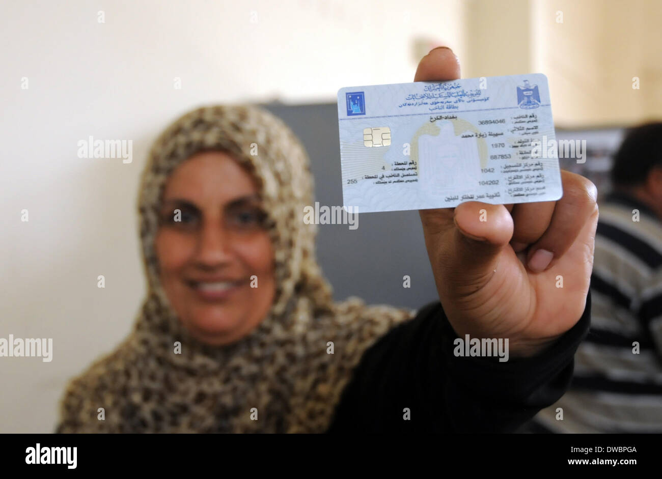 Baghdad, Iraq. 5th Mar, 2014. An electorate shows her electronic voter ID card in Baghdad, Iraq, March 5, 2014. The Iraqi election commission distributes electronic voter ID cards nationwide ahead of the parliamentary election scheduled on April 30. This will be the country's first parliamentary election since the 2011 withdrawal of the U.S. forces. © Liang Youchang/Xinhua/Alamy Live News - Stock Image