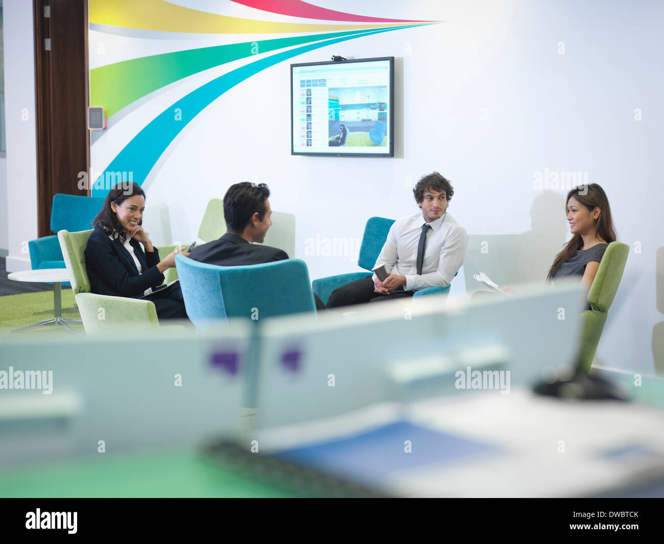 Workers relaxing in modern office - Stock Image