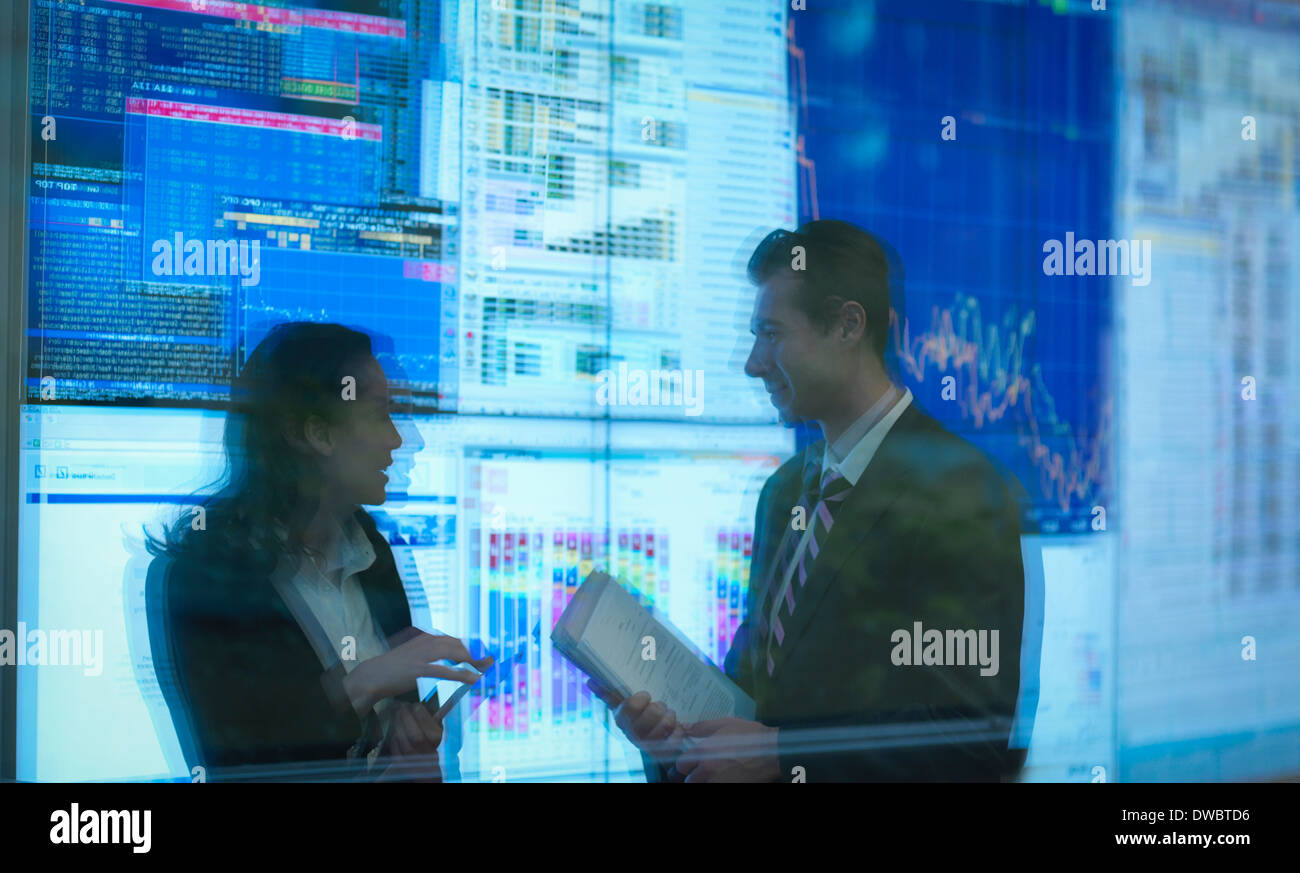 Reflection of business people in front of screens - Stock Image