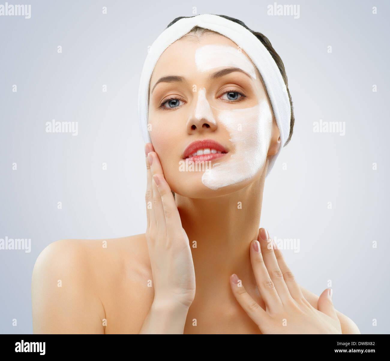beauty women getting facial mask - Stock Image