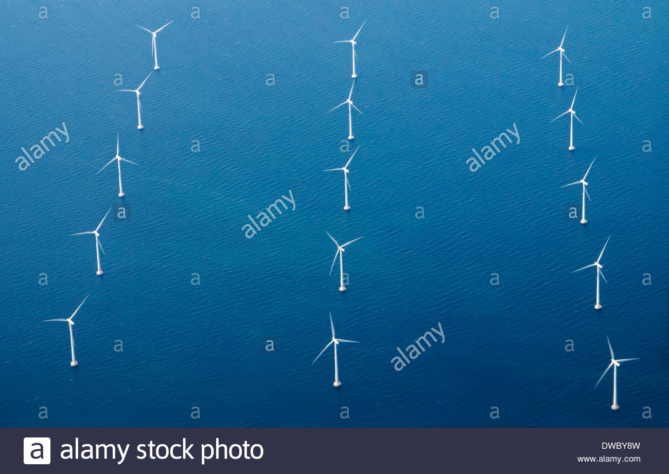 Rows of wind turbines in blue sea Stock Photo