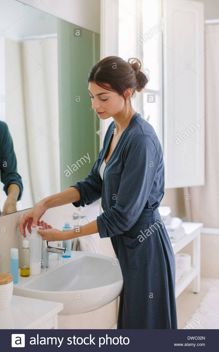Young woman doing her beauty routine - Stock Image