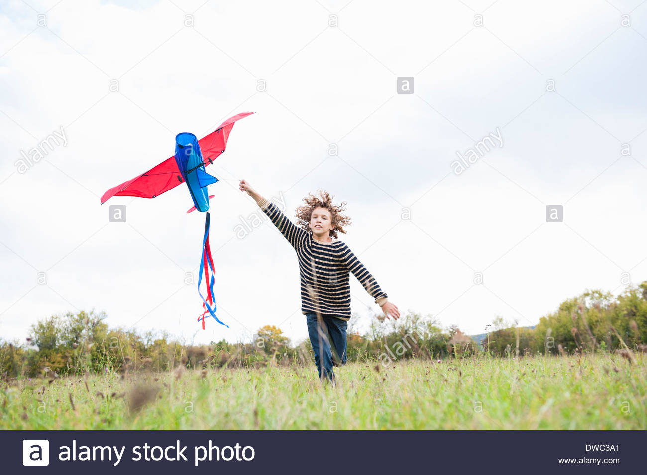 Boy flying kite - Stock Image