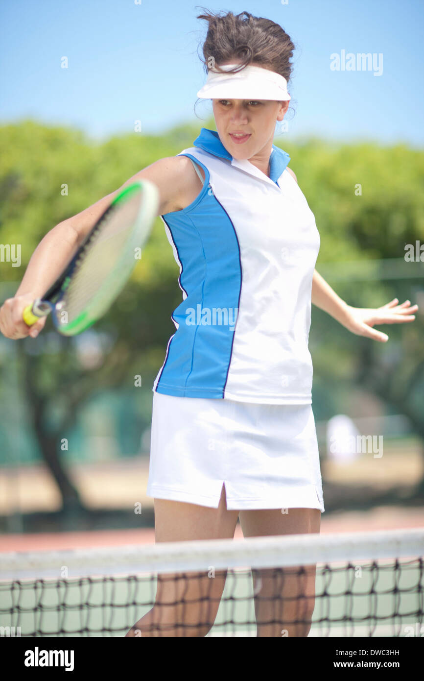 Tennis player hitting backhand volley - Stock Image
