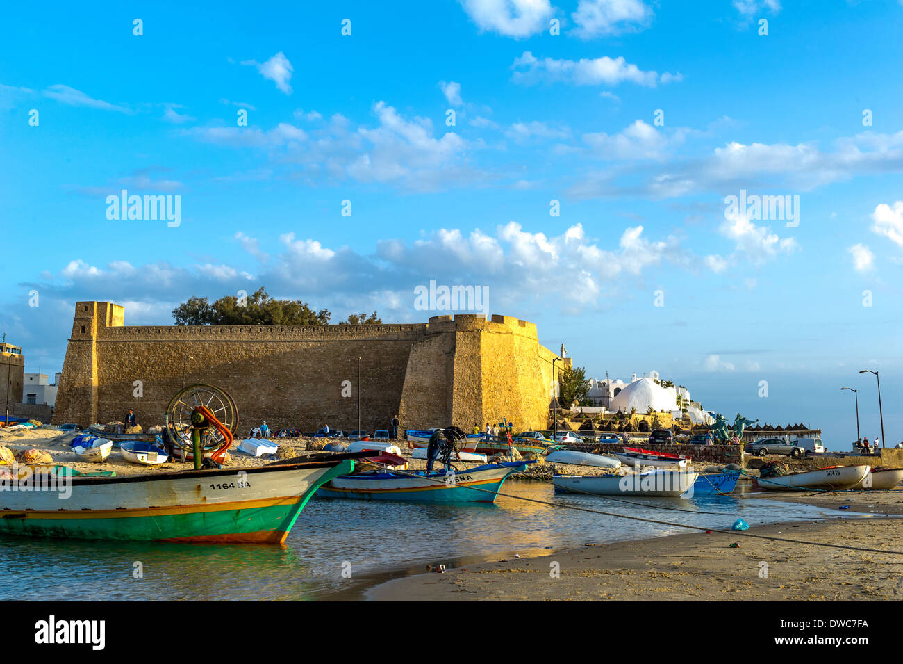 North Africa, Tunisia, Cap Bon, Hammamet, fisher boat front of fortification. - Stock Image