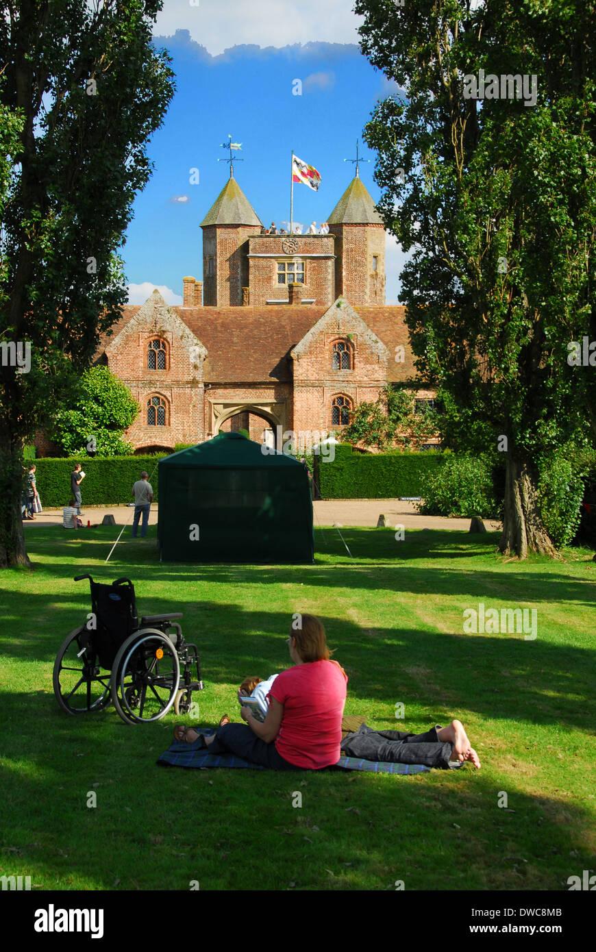 Disabled visitor relaxing near Sissinghurst castle.Kent. UK - Stock Image