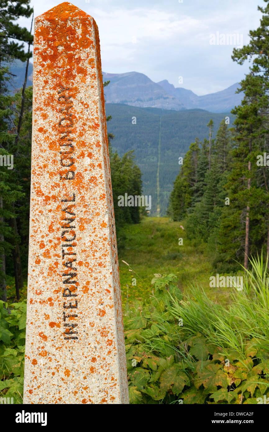 International border marker at Waterton-Glacier International Peace Park at Montana, USA and Alberta, Canada. - Stock Image