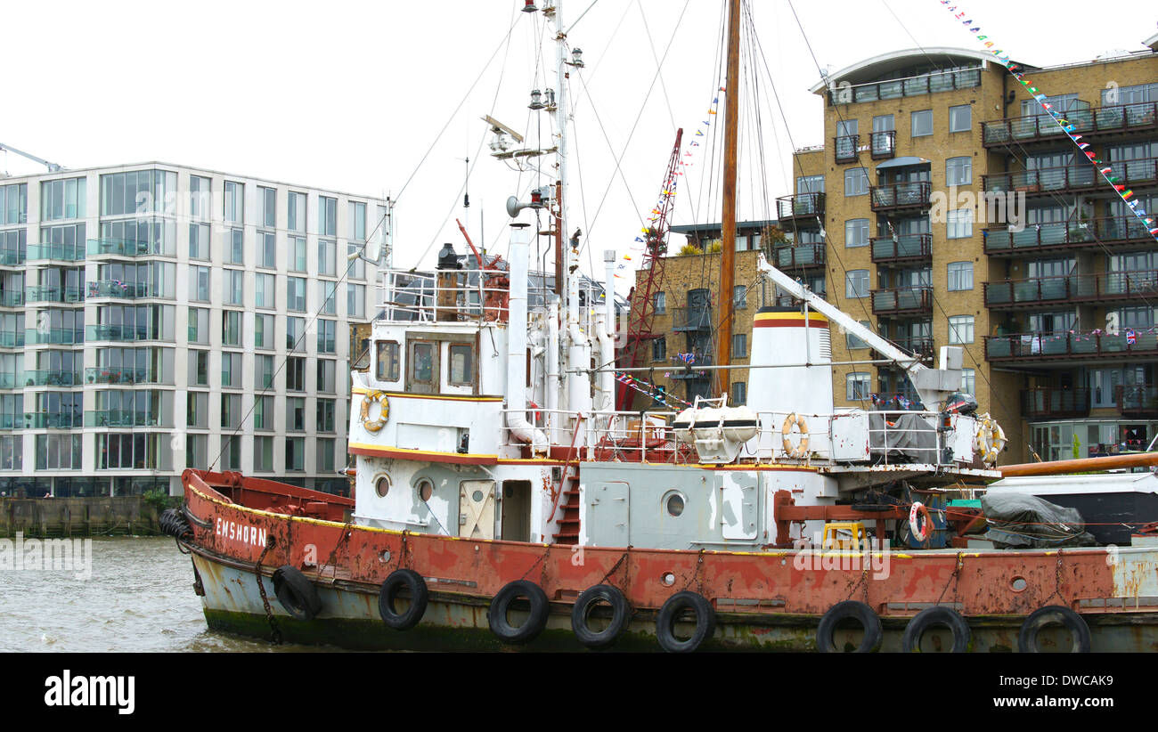 Emshorn  tug / tugboat built 1955 New China Wharf on the River Thames at Bermondsey, London moored during Queens Jubilee - Stock Image