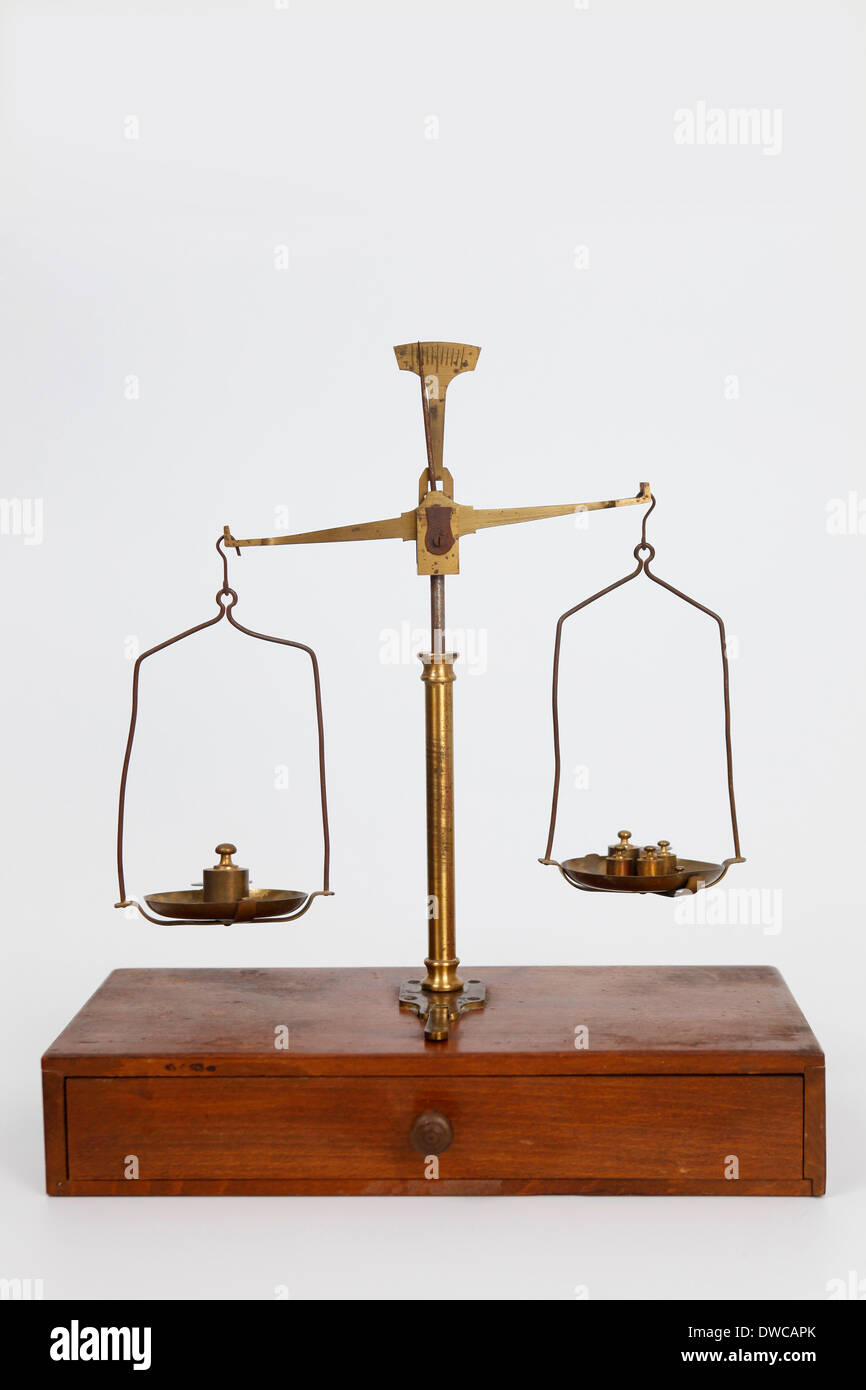 Studioshot of an old weighing machine; scale; balance - Stock Image