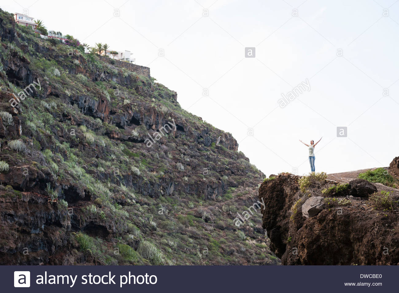 Walker with arms outstretched, Tenerife, Spain - Stock Image
