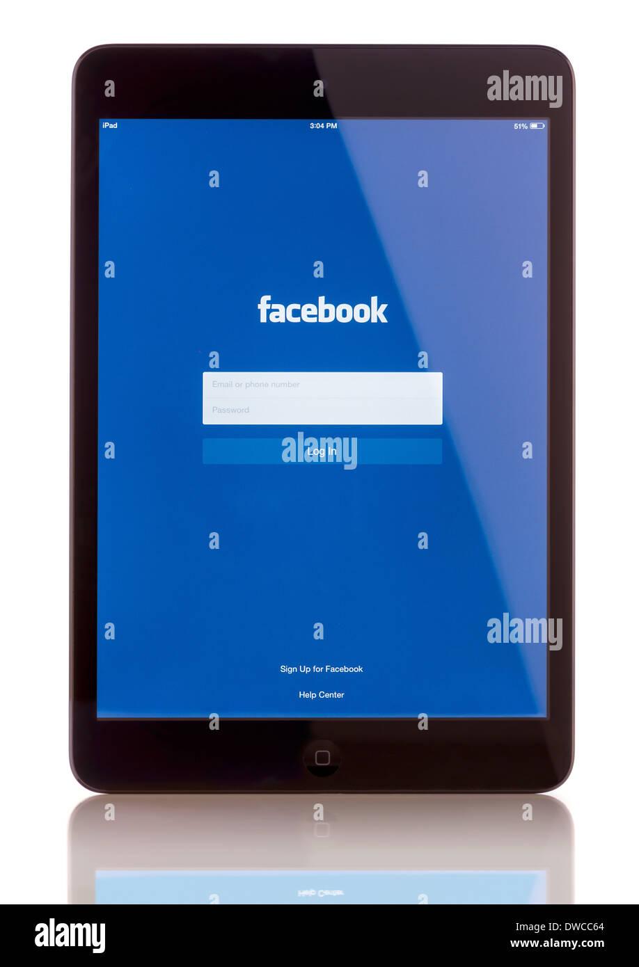 iPad Mini displaying start up screen of Facebook application - Stock Image