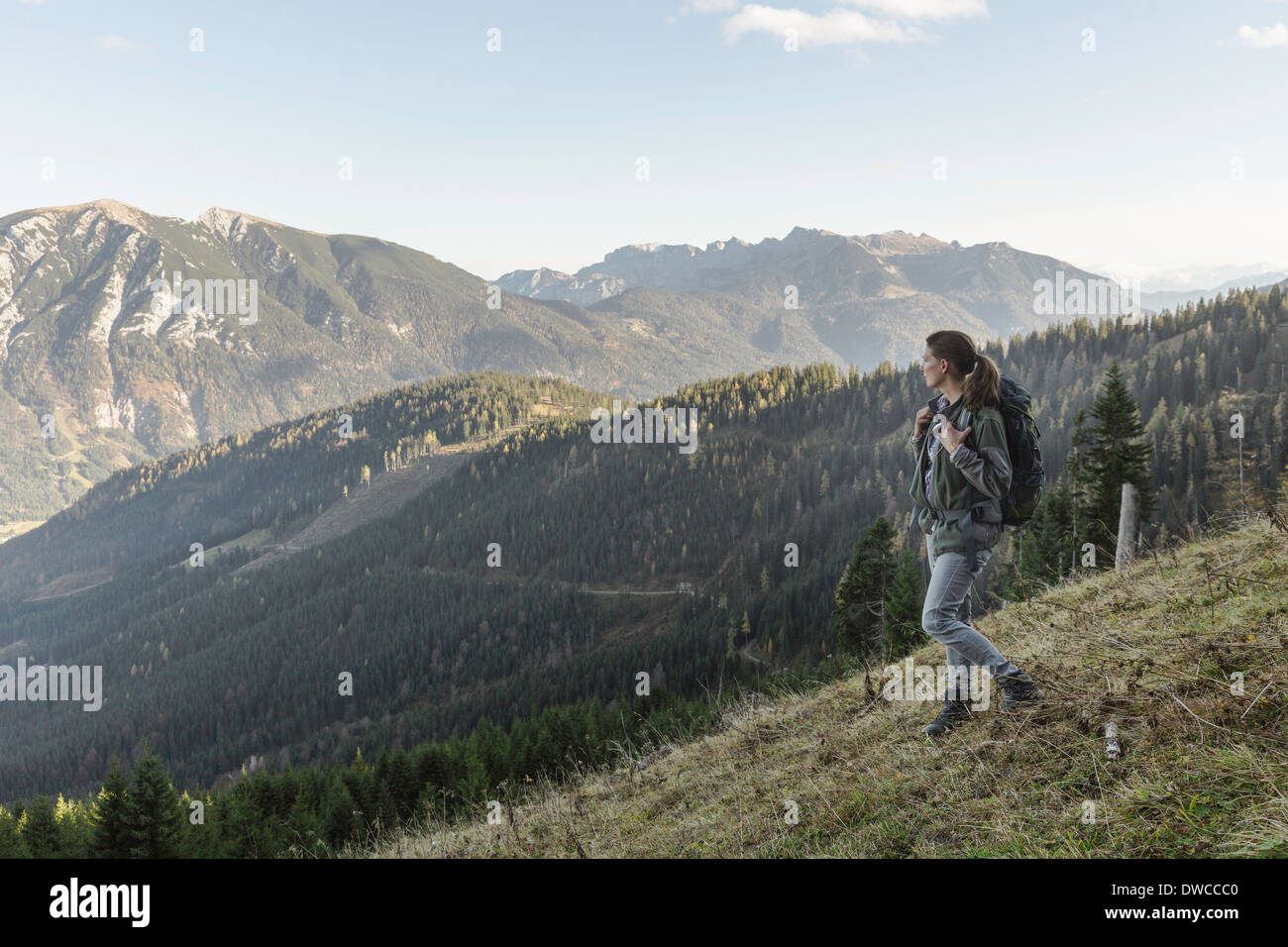 Mid adult woman backpacking in Achensee, Tyrol, Austria - Stock Image