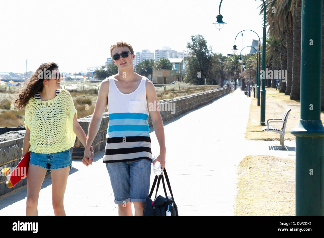 Young couple holding hands, Port Melbourne, Melbourne, Australia - Stock Image