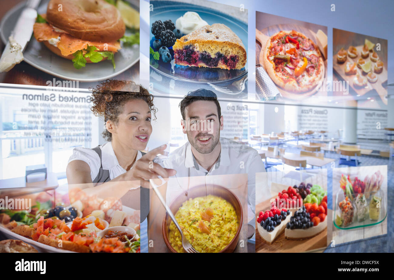 Customers choosing food from interactive display in office canteen - Stock Image