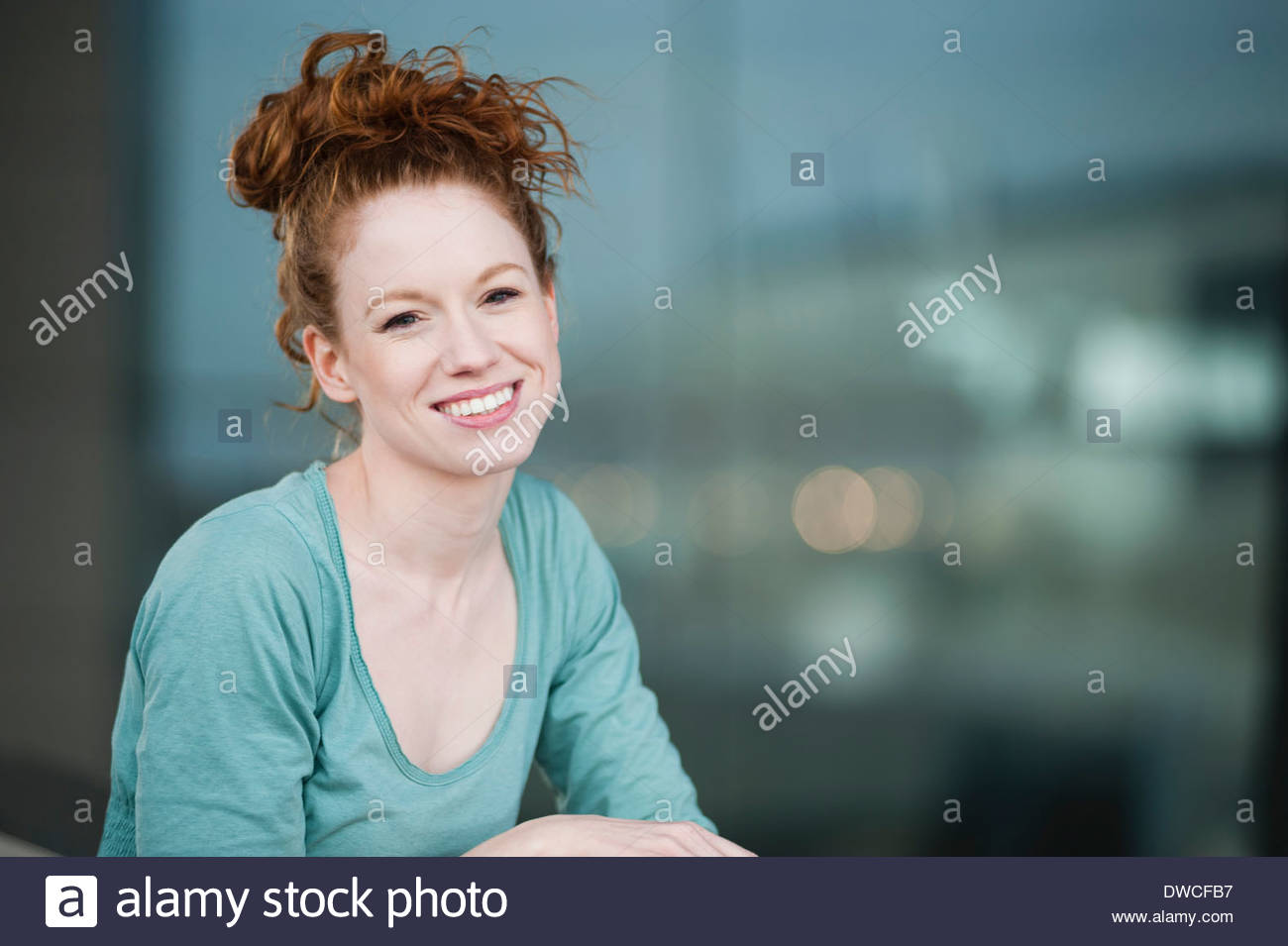 Portrait of happy young woman - Stock Image