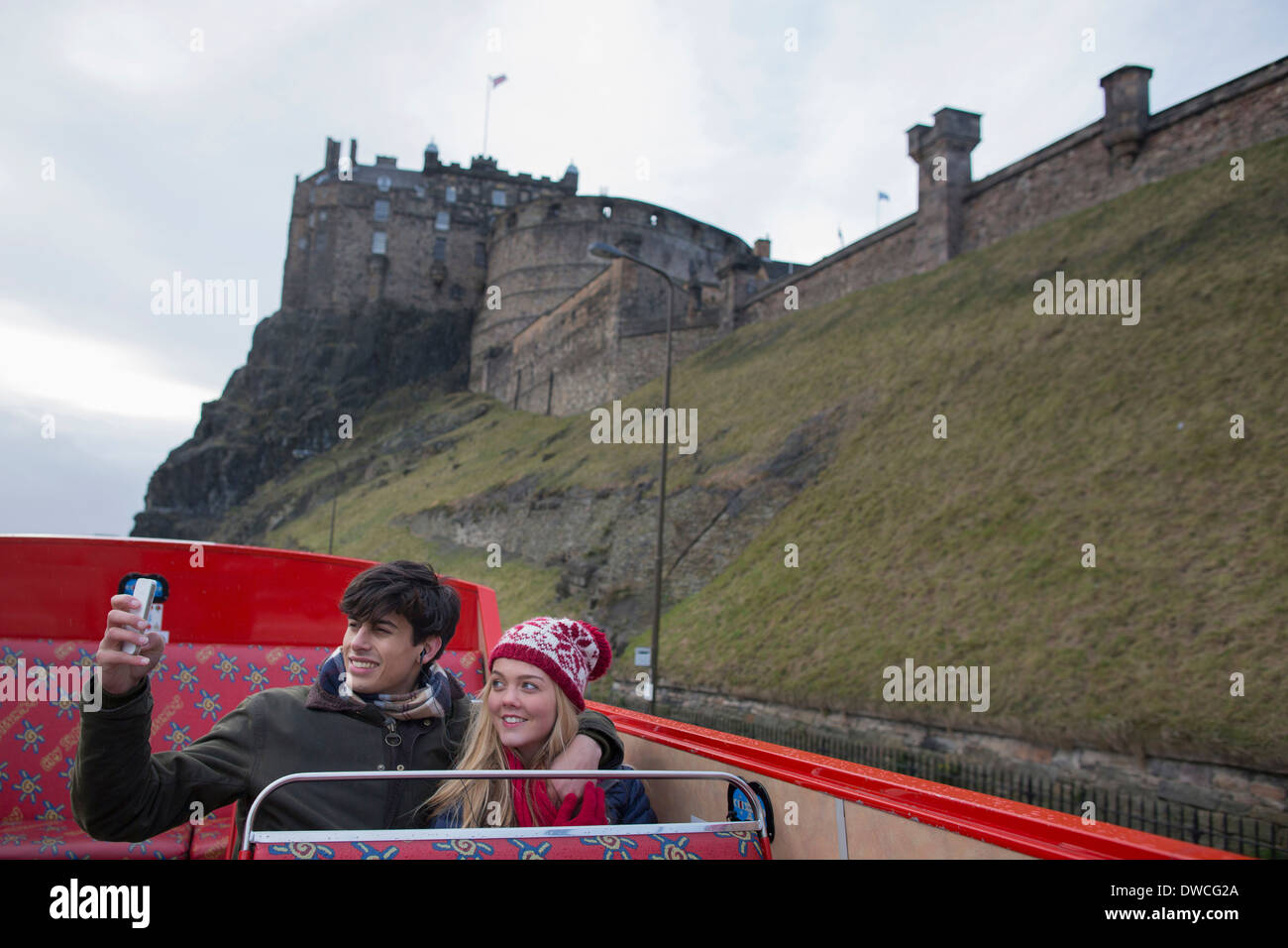 A young couple on an open-top bus tour of Edinburgh Scotland - Stock Image