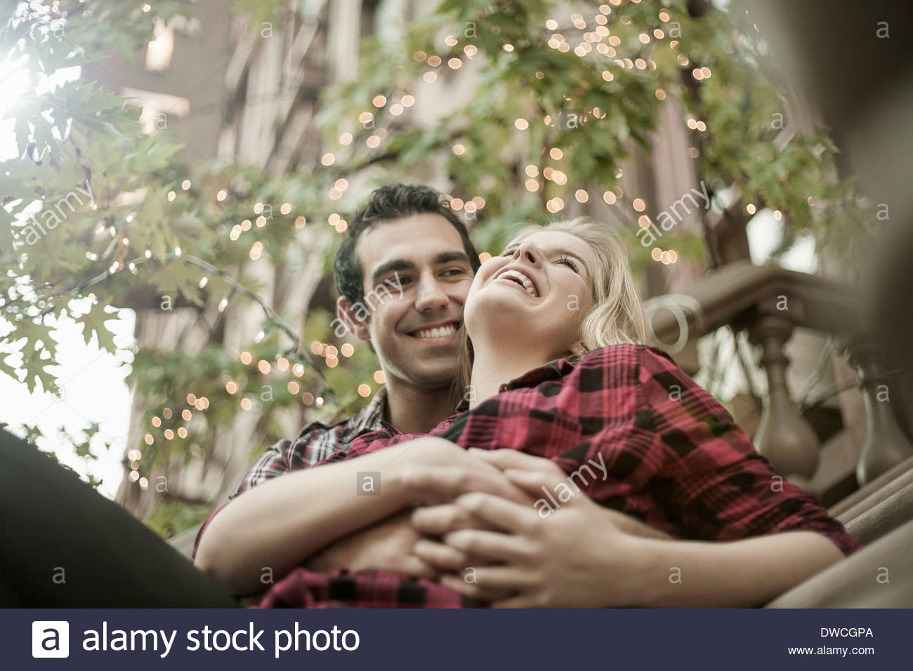 Romantic young couple sitting on steps - Stock Image