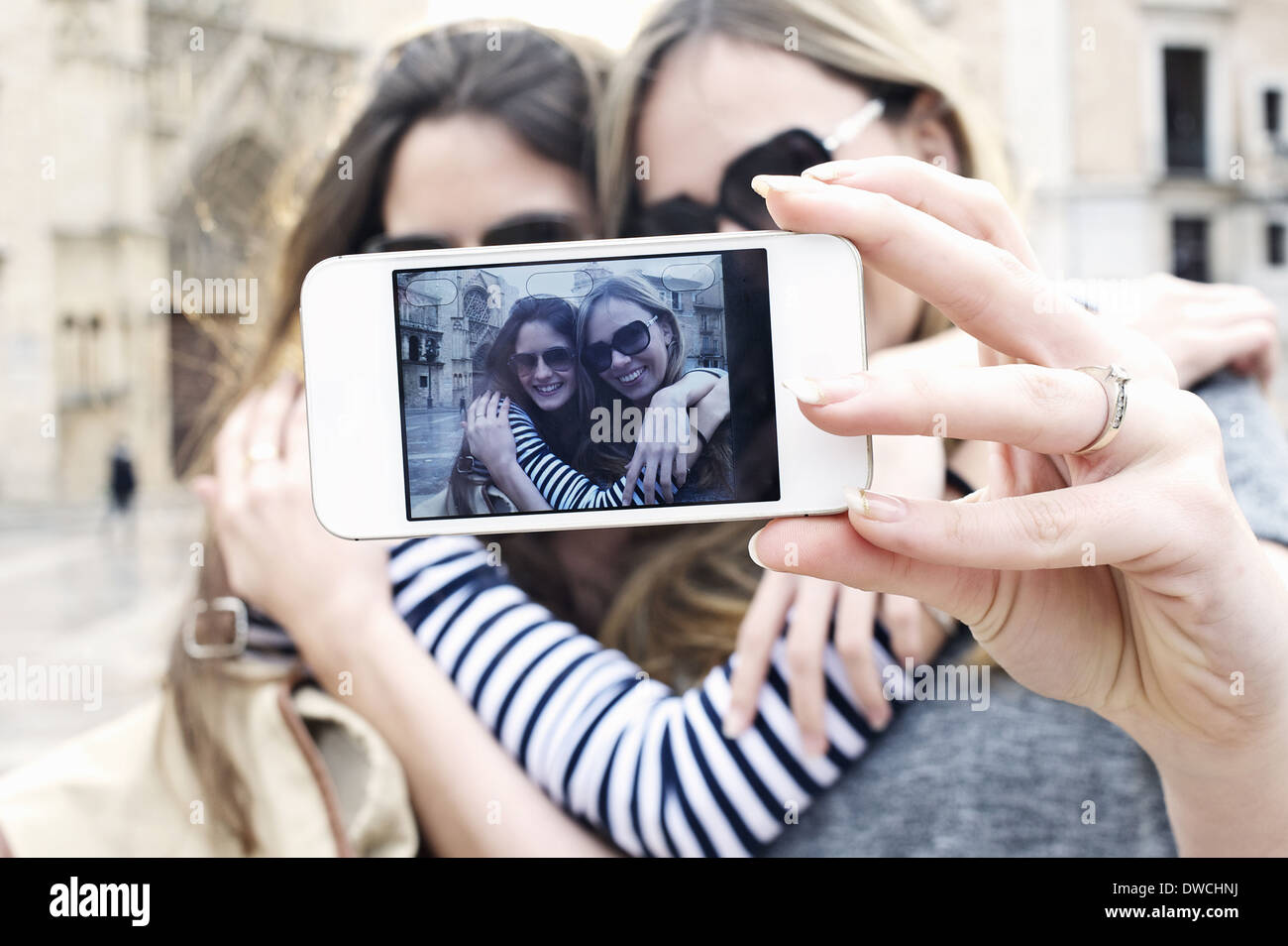 Two young female friends taking a self portrait, Valencia, Spain - Stock Image