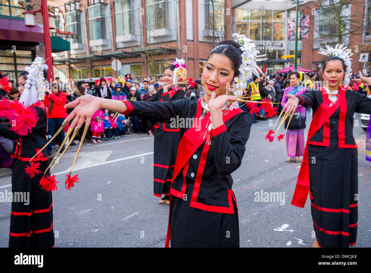 Thai women with brass finger claws, Chinese New Year Parade, Vancouver, British Columbia, Canada - Stock Image