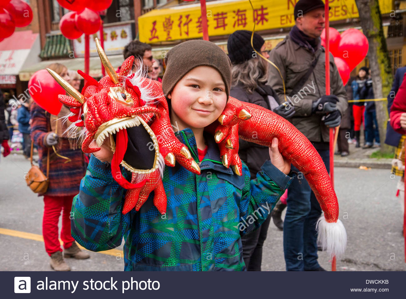 Boy with dragon toy, Chinese New Year Parade, Vancouver, British Columbia, Canada - Stock Image
