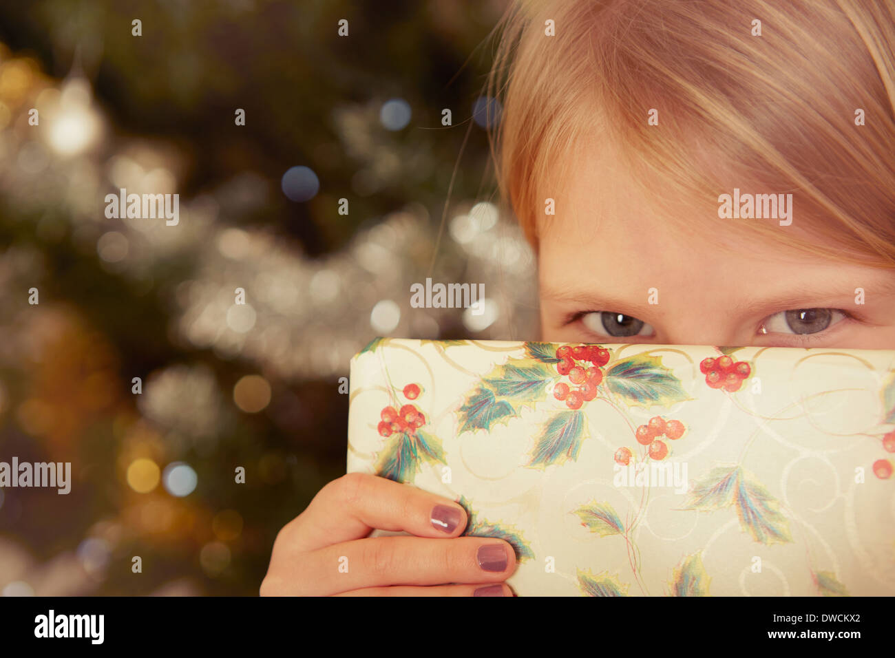 Child with Christmas present - Stock Image