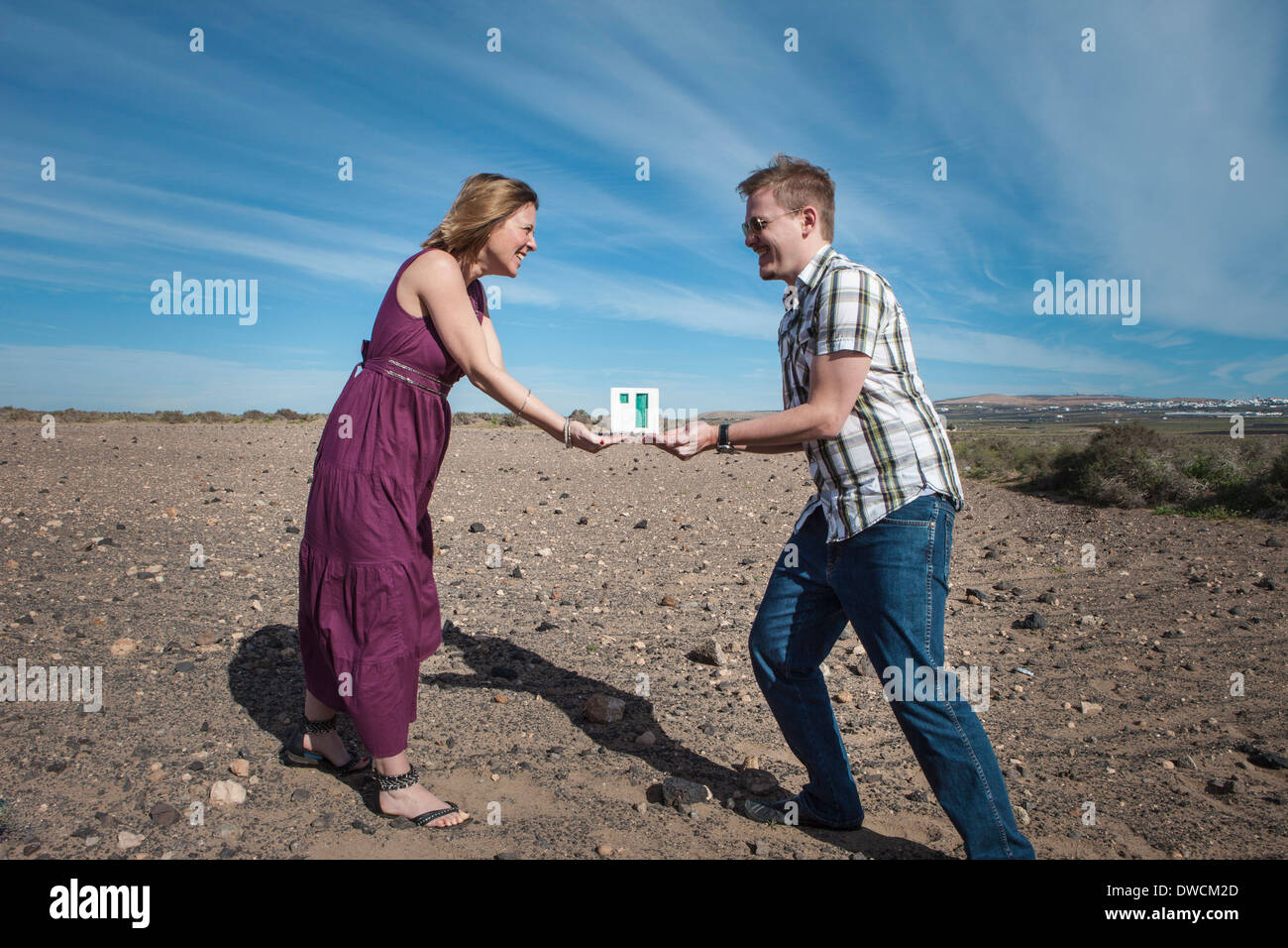 Couple acting out tradition - Stock Image