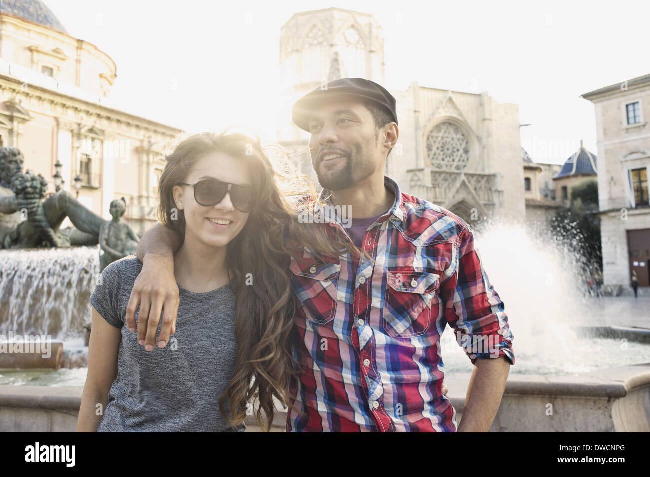 Tourist couple posing, Plaza de la Virgen, Valencia, Spain Stock Photo