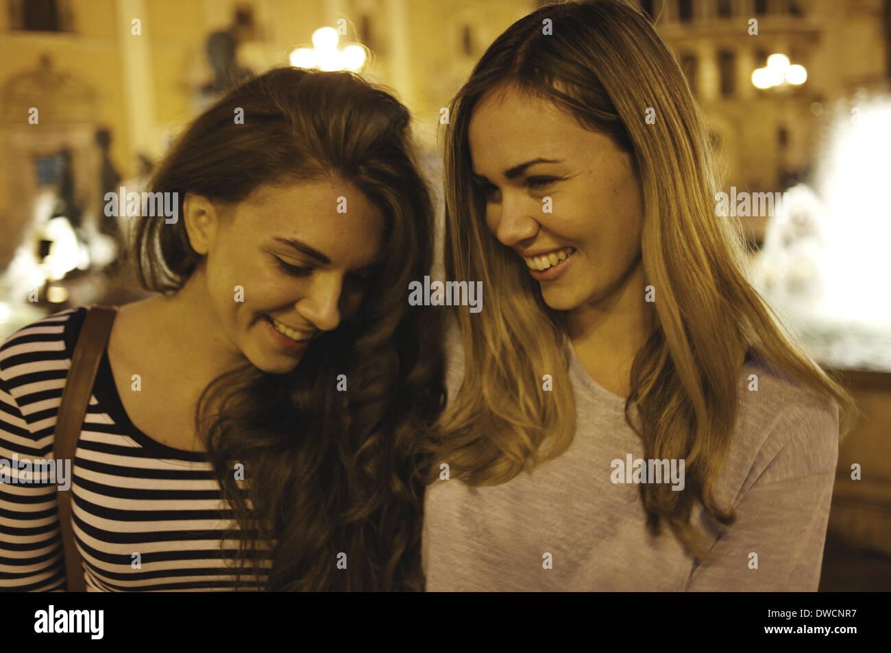 Two young women tourists, Plaza de la Virgen, Valencia, Spain Stock Photo