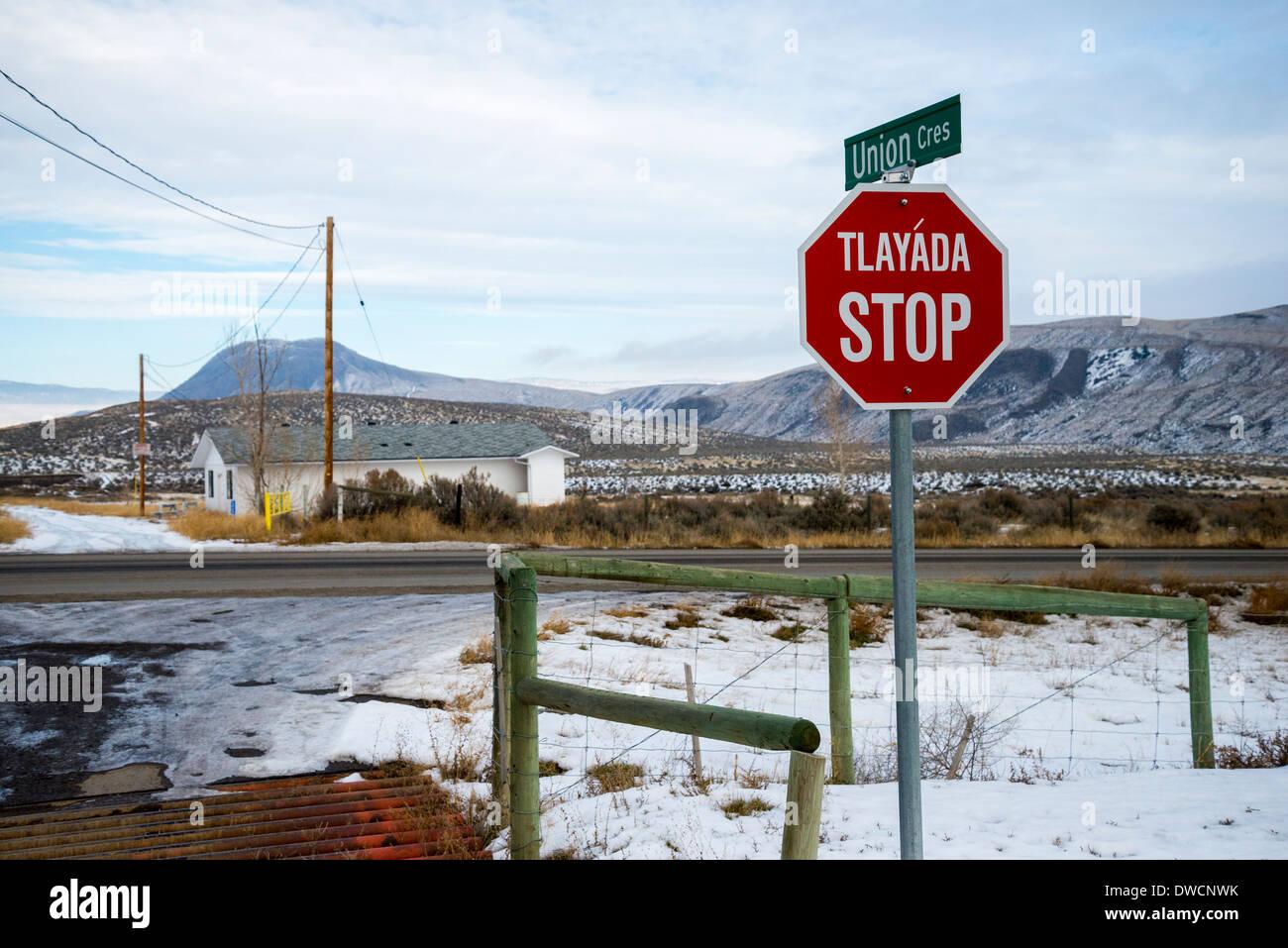 Bilingual stop sign. English and Nl'Akapmx Nation., Ashcroft British Columbia, Canada - Stock Image