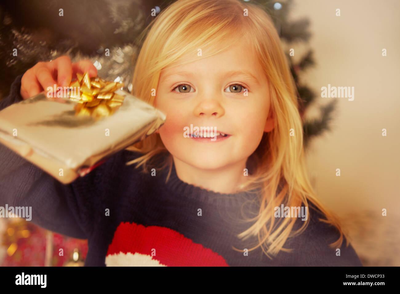 Child holding Christmas present - Stock Image