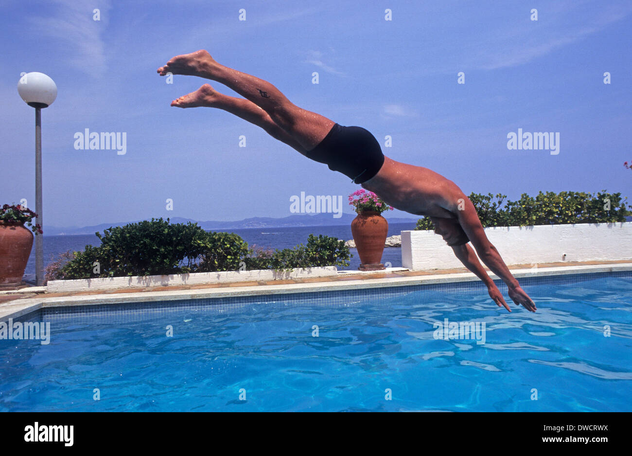 Man Male Diving Into Holiday Swimming Pool Escala Spain