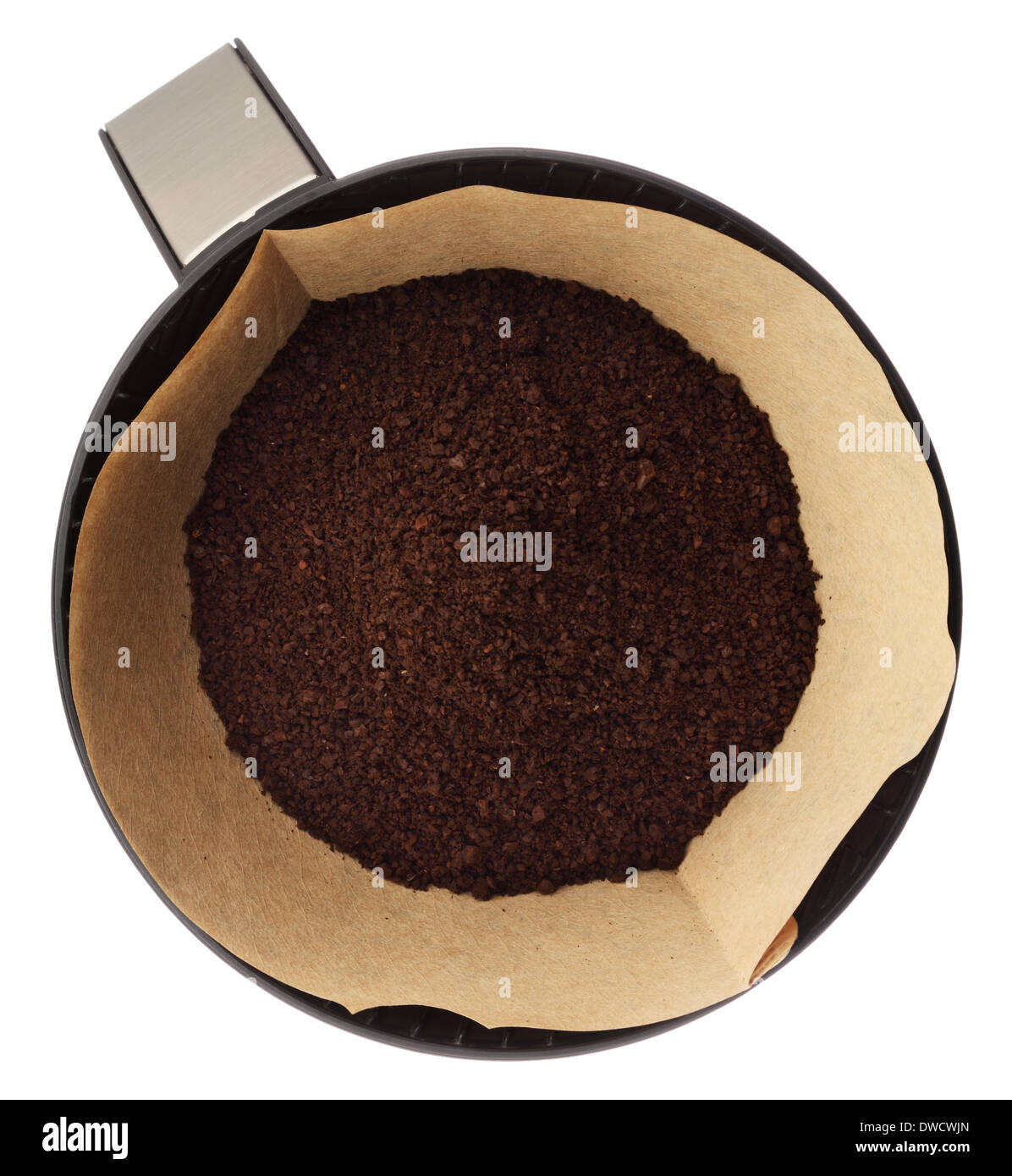 Ground coffee in filter holder isolated on white background overhead view Stock Photo