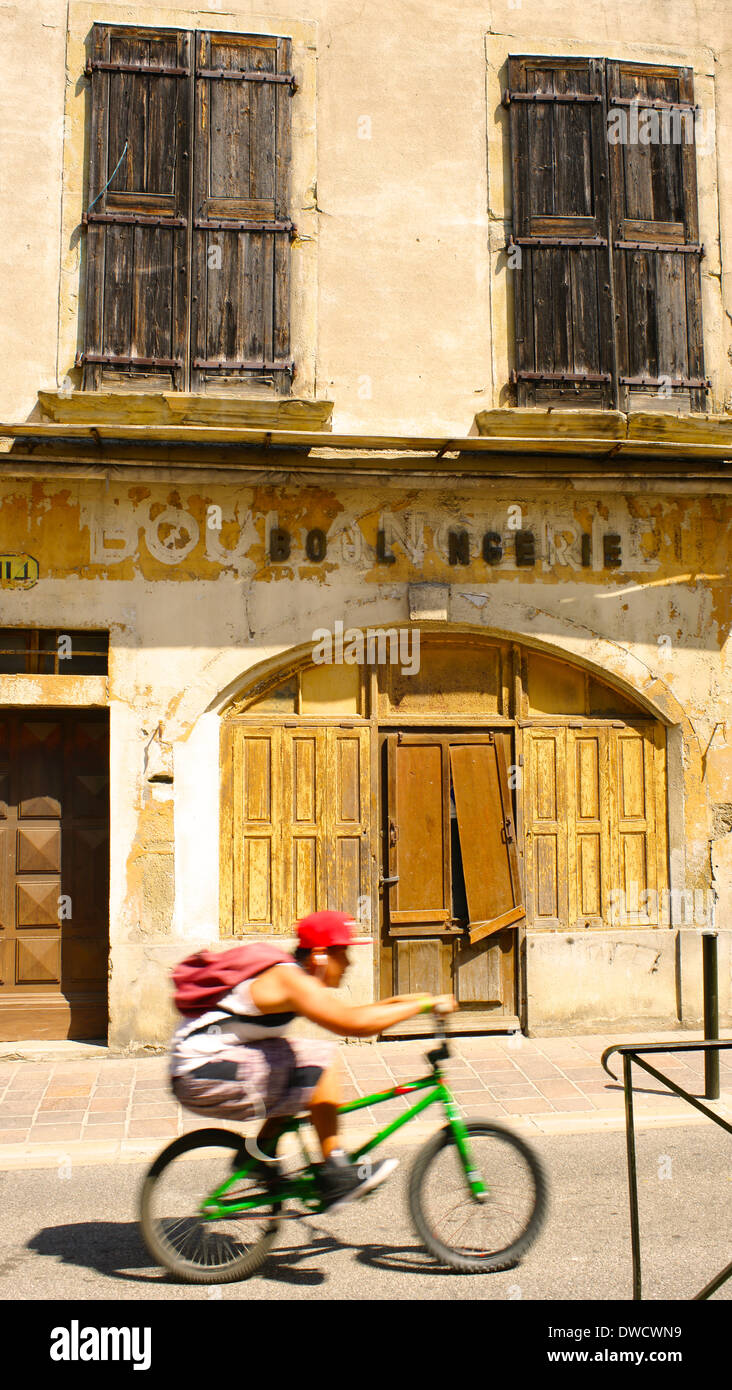 Old shops in Rue Trivalle, Carcassonne, Languedoc-Roussillon, France and boy racer - Stock Image