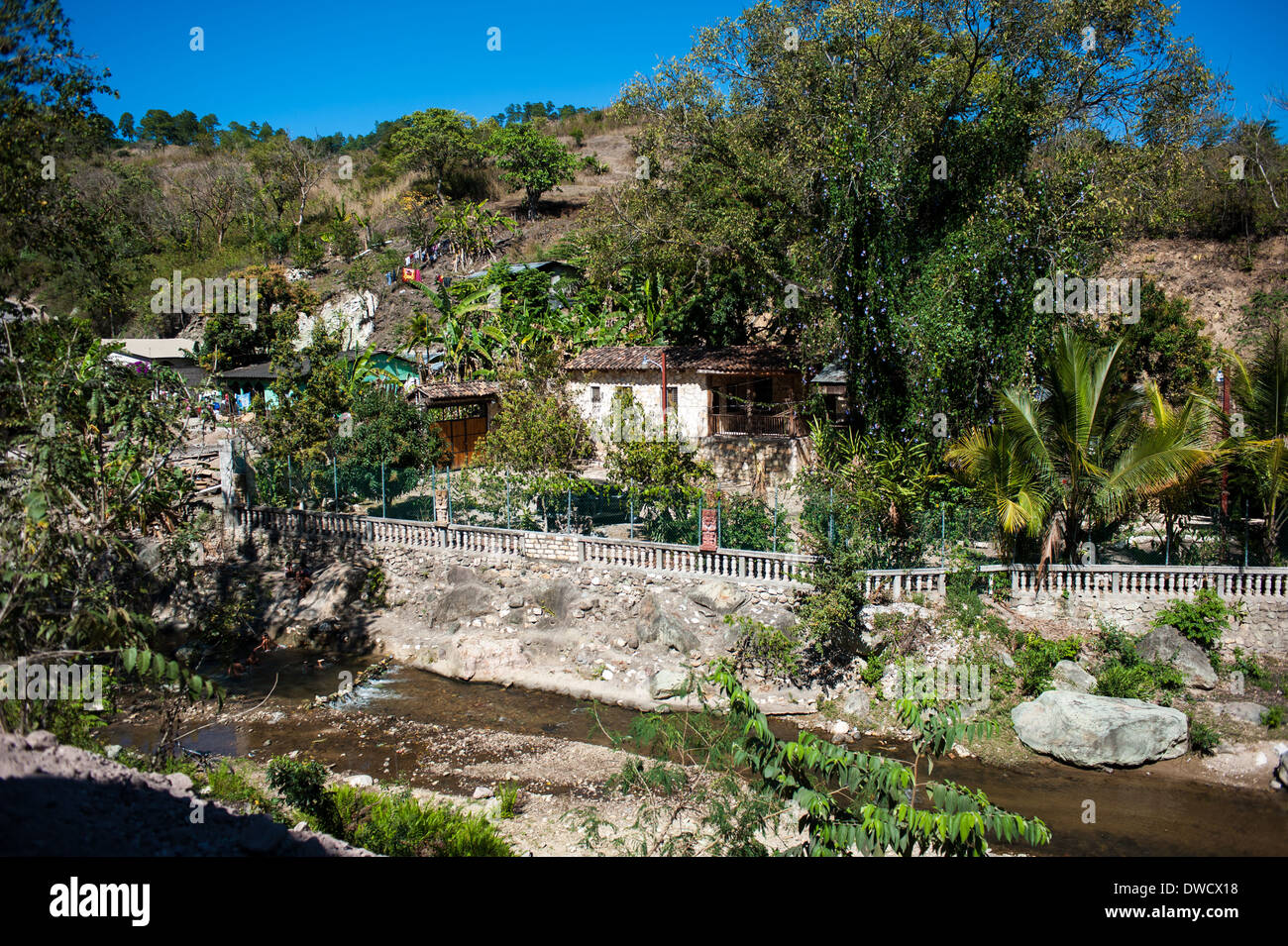 A residential section of Copán Ruinas with the Quebrada Sesesmil flowing beneath. - Stock Image