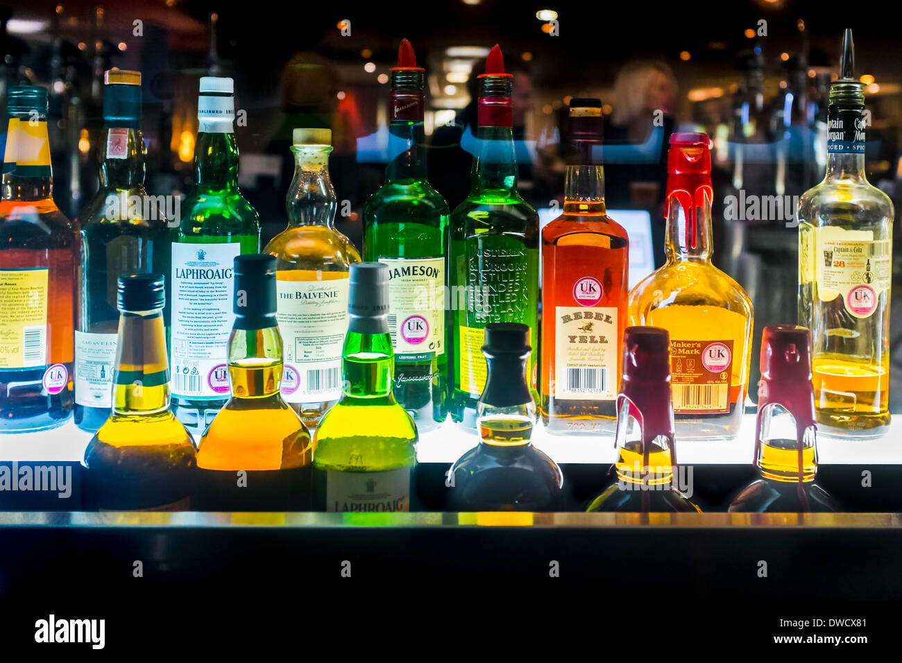 Bottles of alcoholic spirits in bar, London, UK - Stock Image