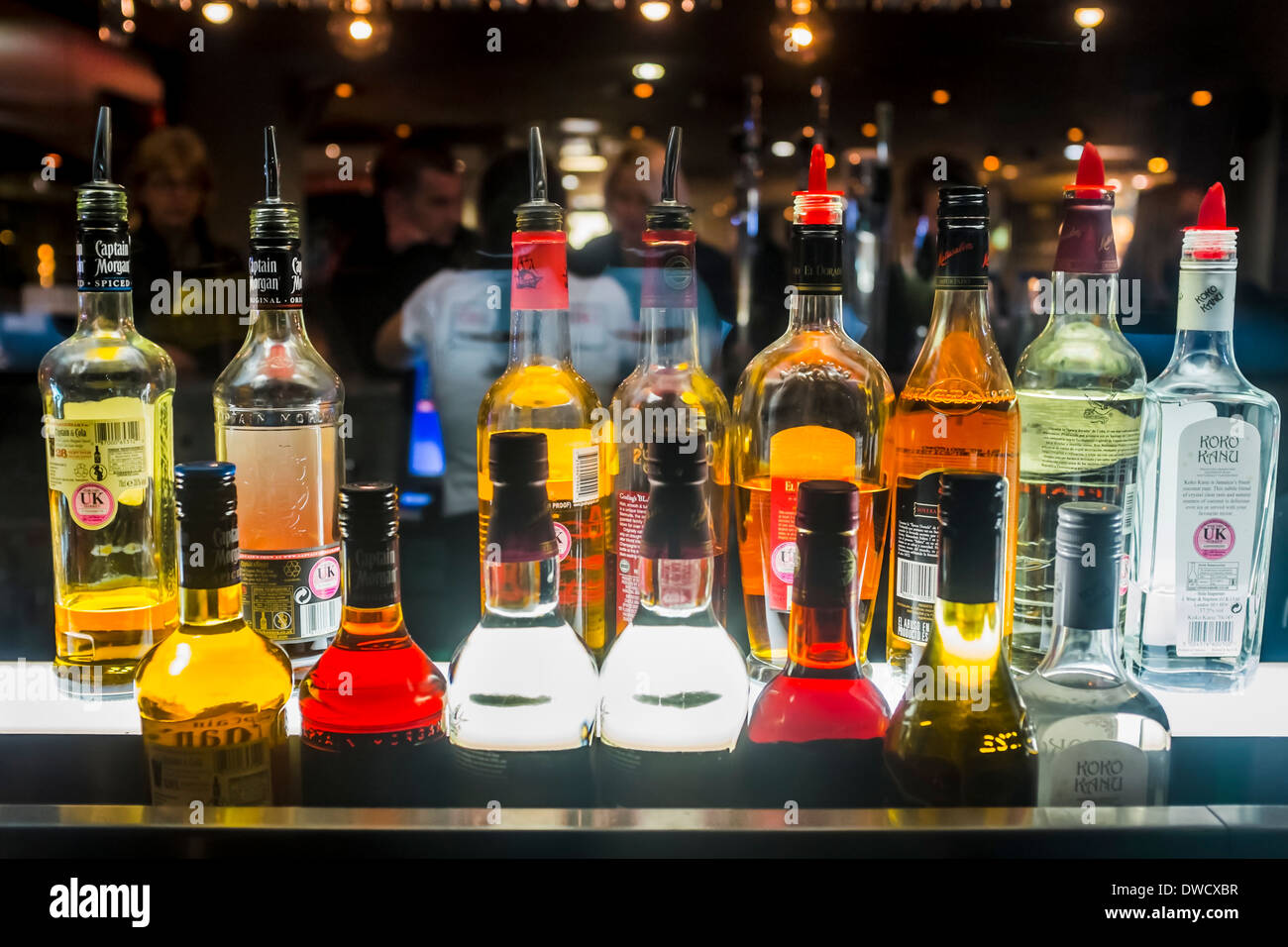 Bottles of alcoholic spirits in cocktail bar, London, UK - Stock Image