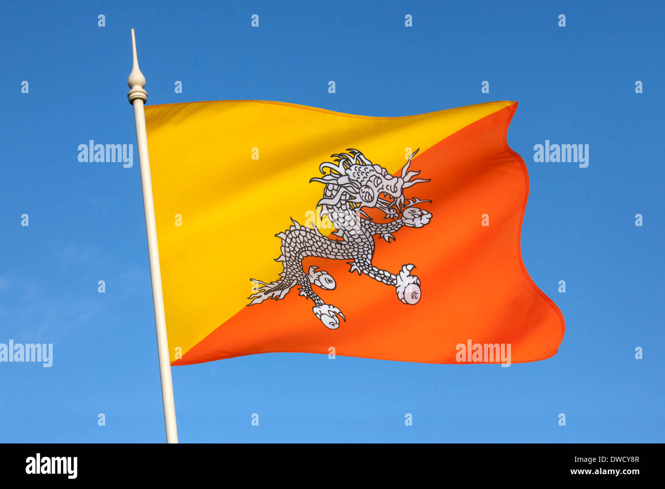 The national flag of The Kingdom of Bhutan - Stock Image