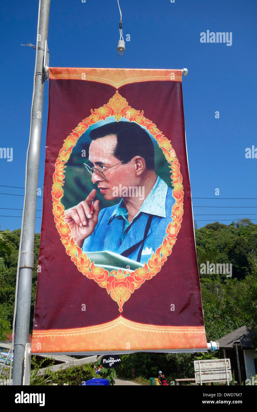 Banner with a picture of Bhumibol Adulyadej, the King of Thailand, sweating heavily, Koh Kood, Thailand. - Stock Image